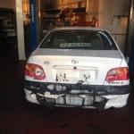 Toyota Avensis - Brandt bagside - Før reparation